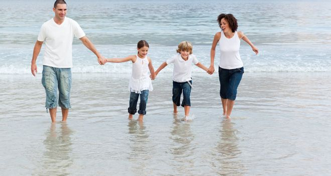 Cute Family on the beach having fun together
