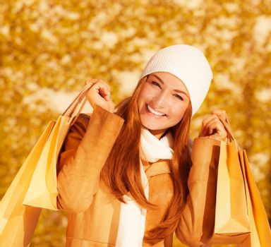 Cheerful woman with paper bags