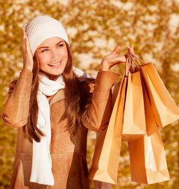 Stylish woman with purchase bags
