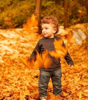 Baby boy in fall backyard