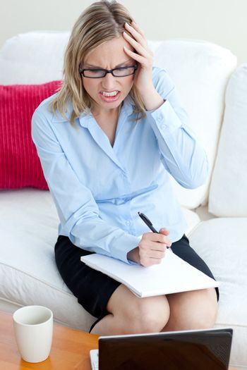 Angry businesswoman sitting on a sofa