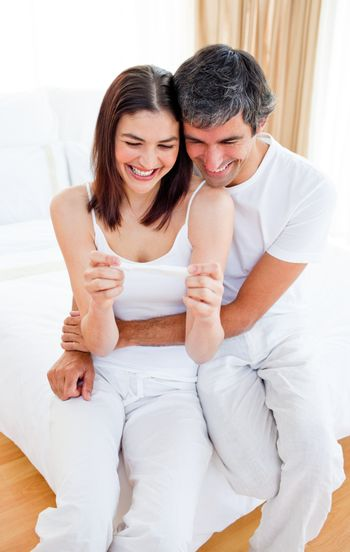 Happy couple finding out results of a pregnancy test