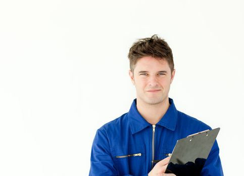 Good-looking male worker holding a document