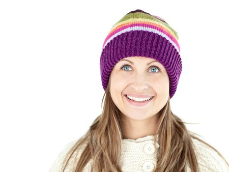 Smiling woman wearing a cap and pullover
