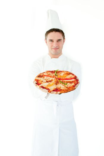 Young male cook smell at pizza with closed eyes
