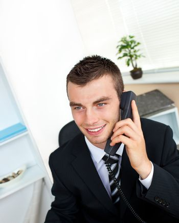 Sophisticated young businessman talking on phone