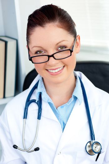 Sophisticated female doctor smiling at the camera
