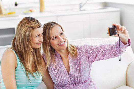 Female friends doing pictures of themselves