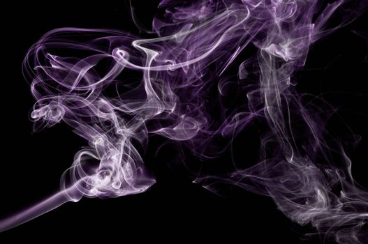 An abstract image of purple smoke set against a black background.