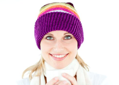 Glowing woman wearing a white pullover and a colorful hat