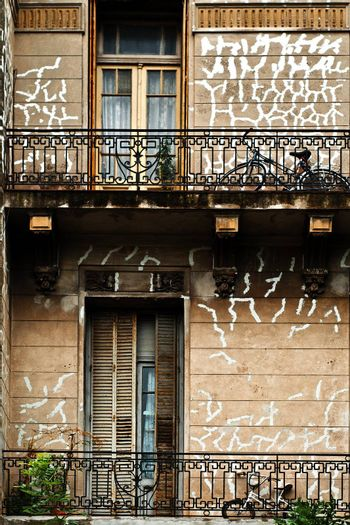 Bicycles sitting on old dilapidated balconies in Buenos Aires, Argentina.
