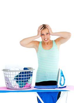 Upset woman ironing