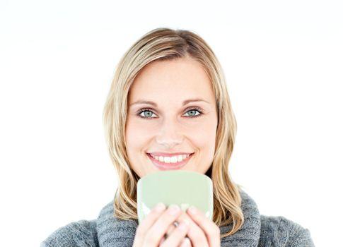 Joyful woman wearing a pullover enjoying a hot coffee