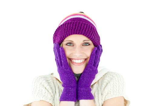 Positive woman with a colorful hat and a pullover smiling at the