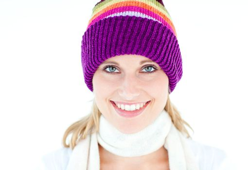 Glowing young woman wearing white pullover and colorful hat