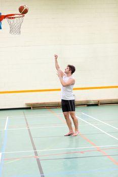 Good-looking man playing basketball