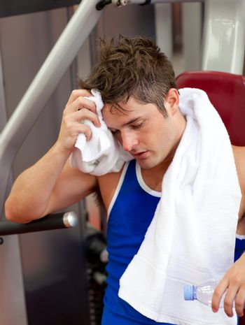 Tired man using a bench press