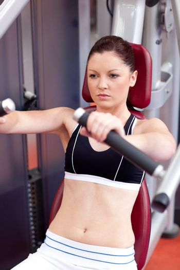 Positive athletic woman using a bench press