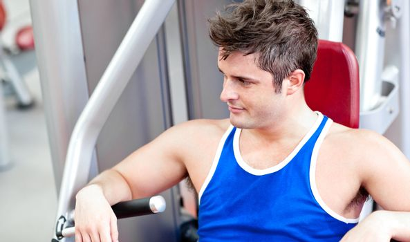 Relaxed young man using a bench press