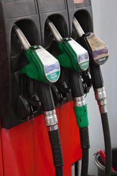 Gasoline pumps nozzles at petrol station