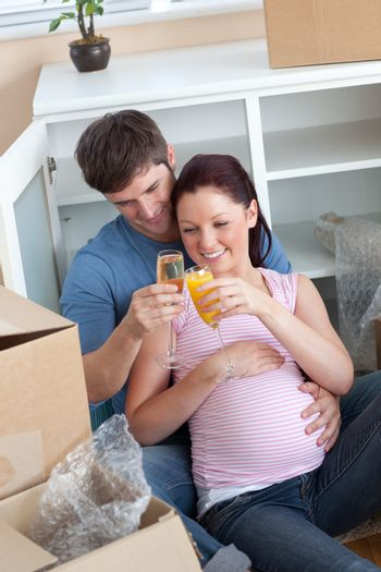 cheerful couple celebrating pregnancy and removal with champagne
