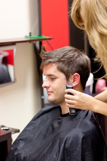 Young caucasian man being shaved