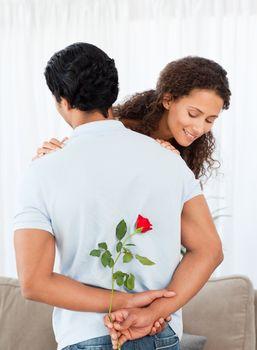 Beautiful woman finding a rose hidden by his boyfriend