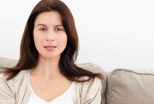 Serene woman sitting on the sofa