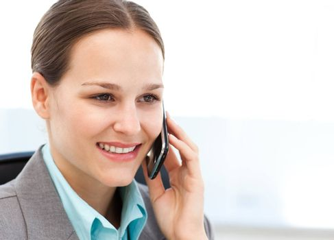 Female executive using her cellphone at her desk in the office