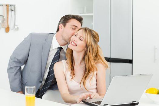 Businessman kissing her girlfriend