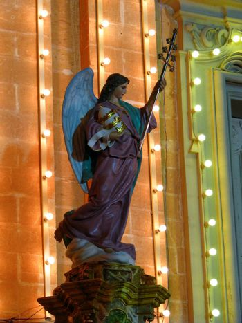 A papier mache angel being part of various street decorations for the feast of Saint Joseph in Ghaxaq, Malta.
