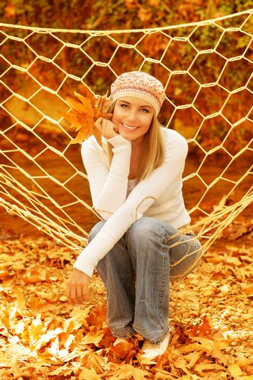 Woman sitting in hammock