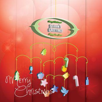 Christmas card with hanging Christmas decoration