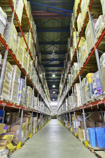 Indoor warehouse with lot of pallet. Wide angle photo.