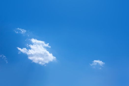 Blue sky with one cumulus