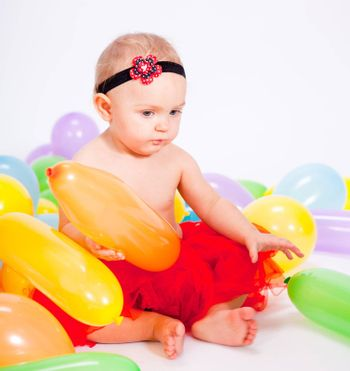 cute little baby child with colorfull balloons birthday celebration