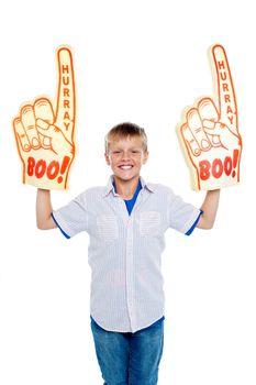 Energetic young boy showing true fan spirit