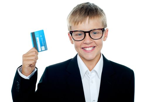 Young kid in business suit flaunting a debit card