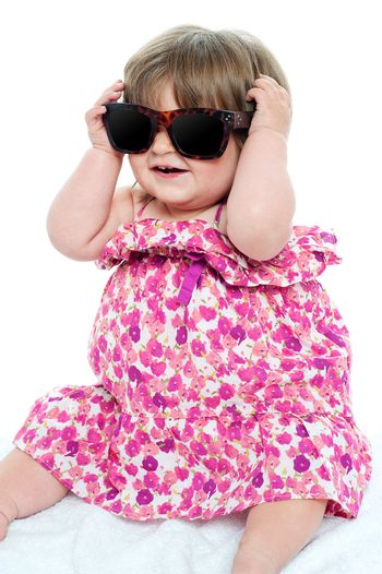 Cute little toddler wearing classy shades