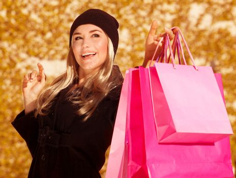 Happy female with presents bags