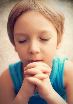 Photo boy at prayer