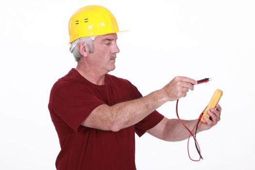 Electrician using multimeter