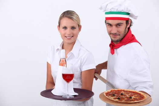 Pizza chef and waitress