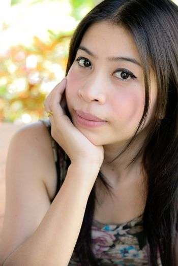 asian girl relaxe  rest one's chin on one's hands