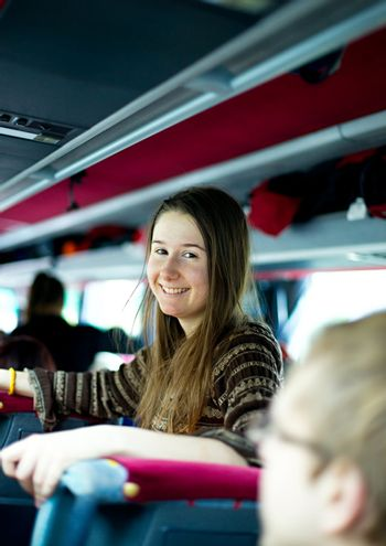 Smiling girl traveling by bus