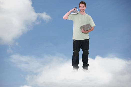 Montage of a smiling bricklayer standing on a cloud