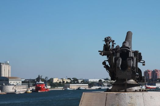 Cannon facing the port of Brindisi, with view of the port behind