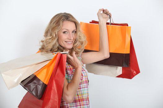 A smiling woman who enjoyed a shopping spree.
