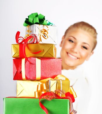 Happy girl with many gifts