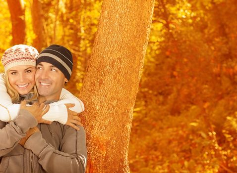 Young family in fall woods